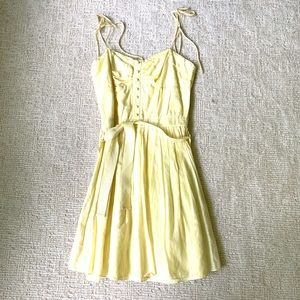 Yellow cotton sun dress with button detail